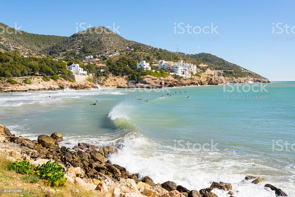 Surfers enjoying the waves in a beach in Spain stock photo