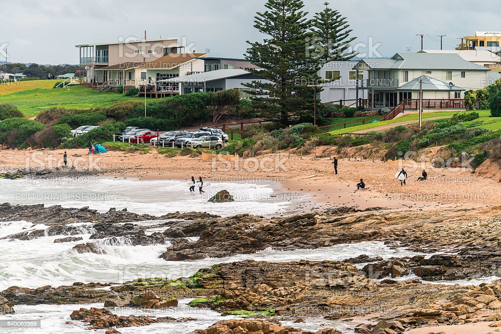 Surfers entering water stock photo
