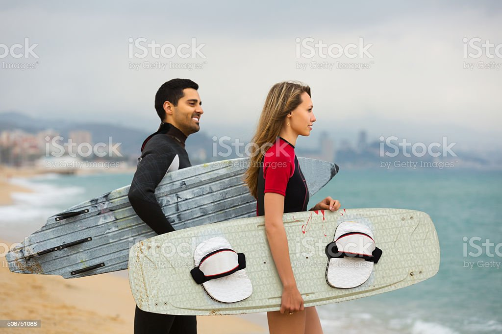 Surfers family on the beach stock photo