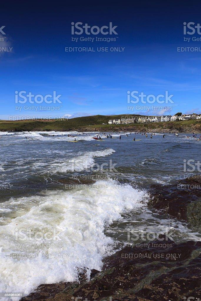 surfers in the Atlantic Ocean at Polzeath royalty-free stock photo