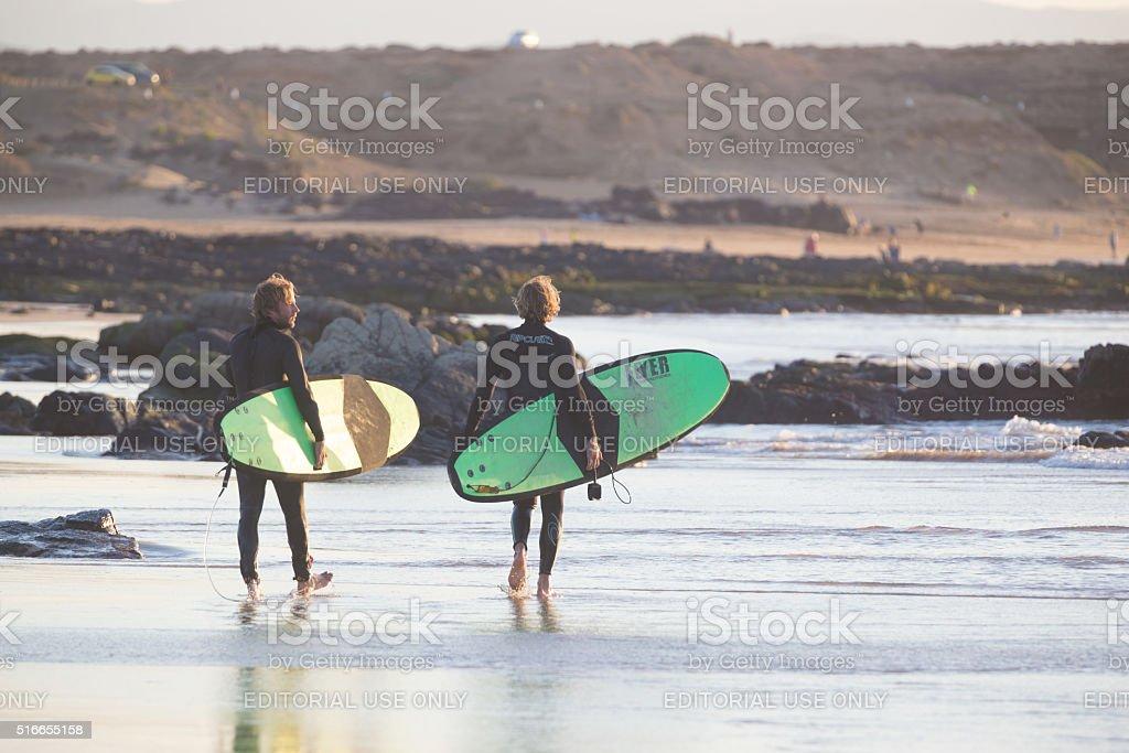 Surfers on El Cotillo beach, Fuerteventura, Canary Islands, Spain. stock photo