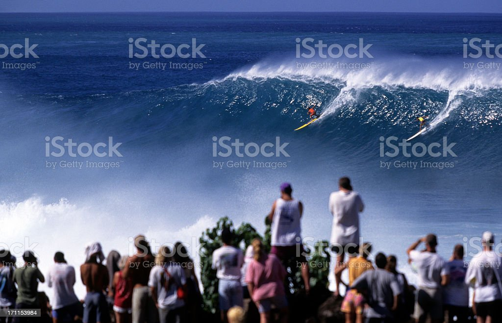 Surfers on North Shore of Waimea Bay, Hawaii Oahu, USA stock photo