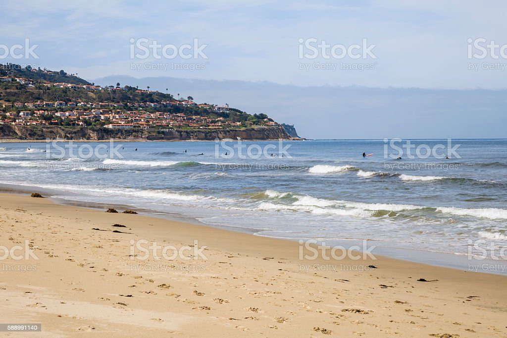 Surfers On The Pacific Ocean Below Palos Verdes California stock photo