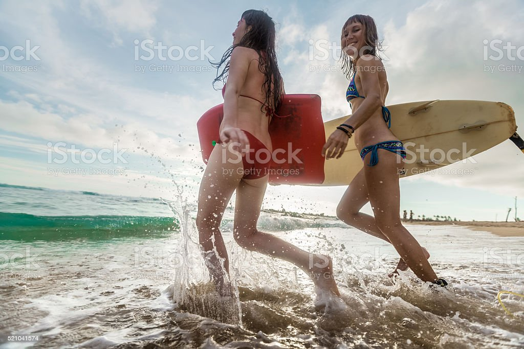 Surfers stock photo
