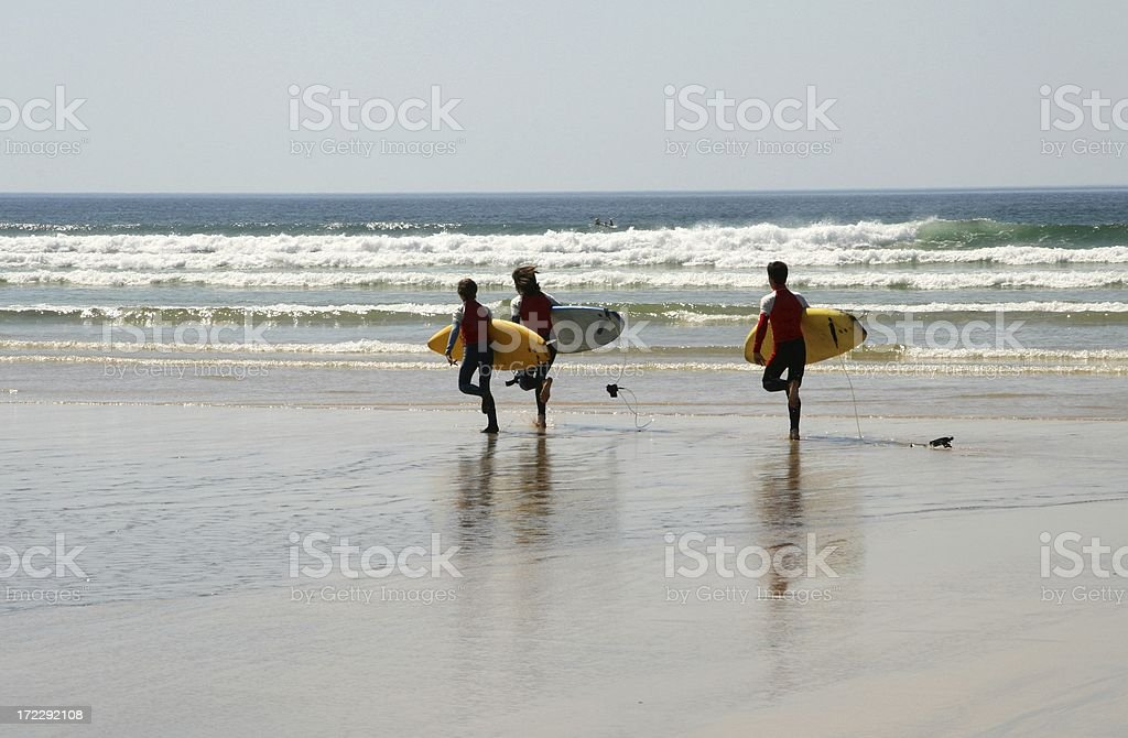 Surfers Race for the Waves stock photo