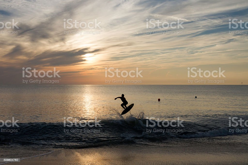 Surfer's Silhouette at sunrise stock photo