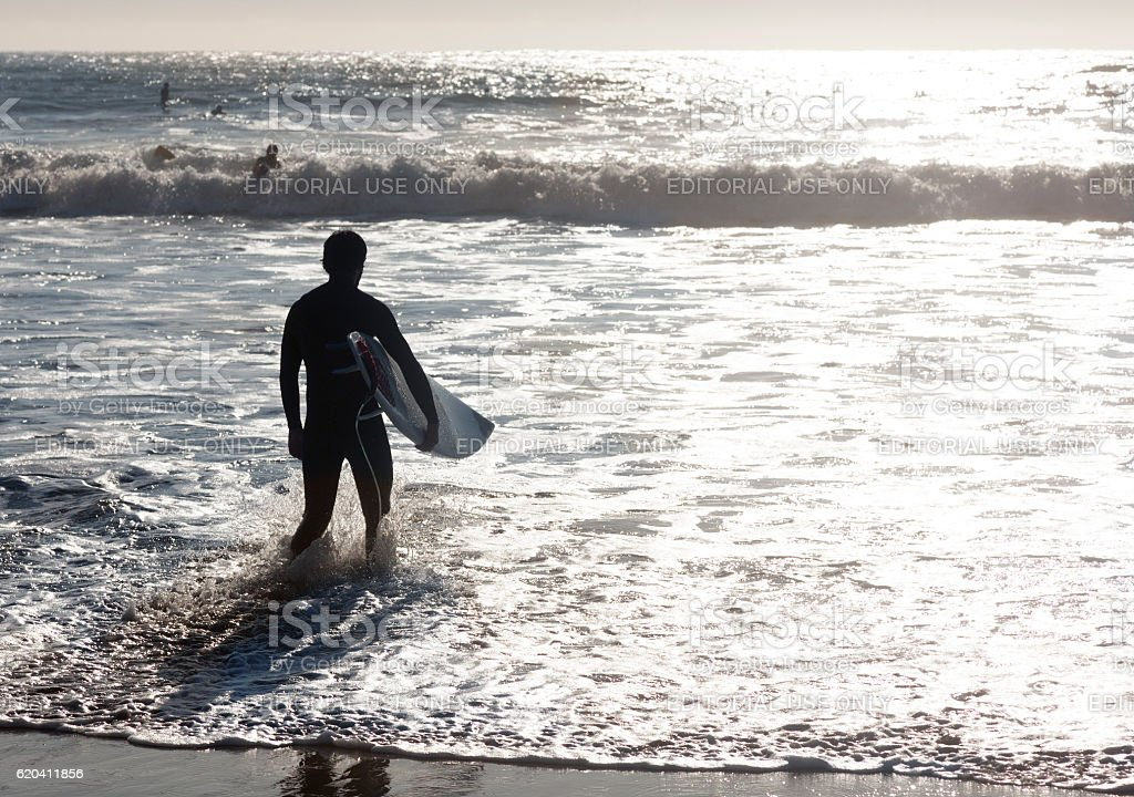 Surfers silhouette stock photo