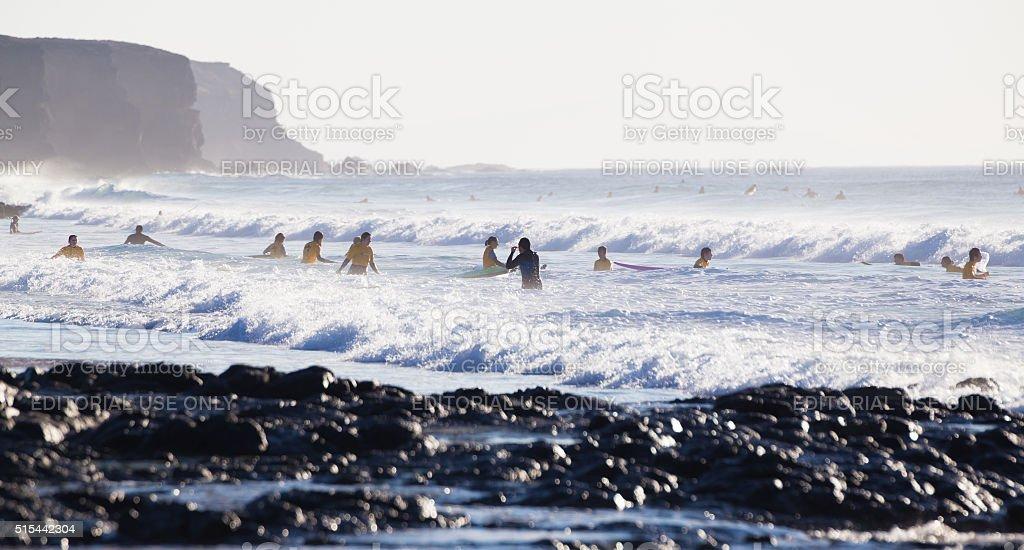 Surfers surfing on El Cotillo beach, Fuerteventura, Canary Islands, Spain. stock photo