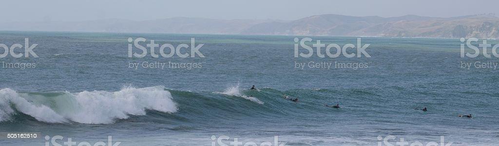 surfers waiting stock photo