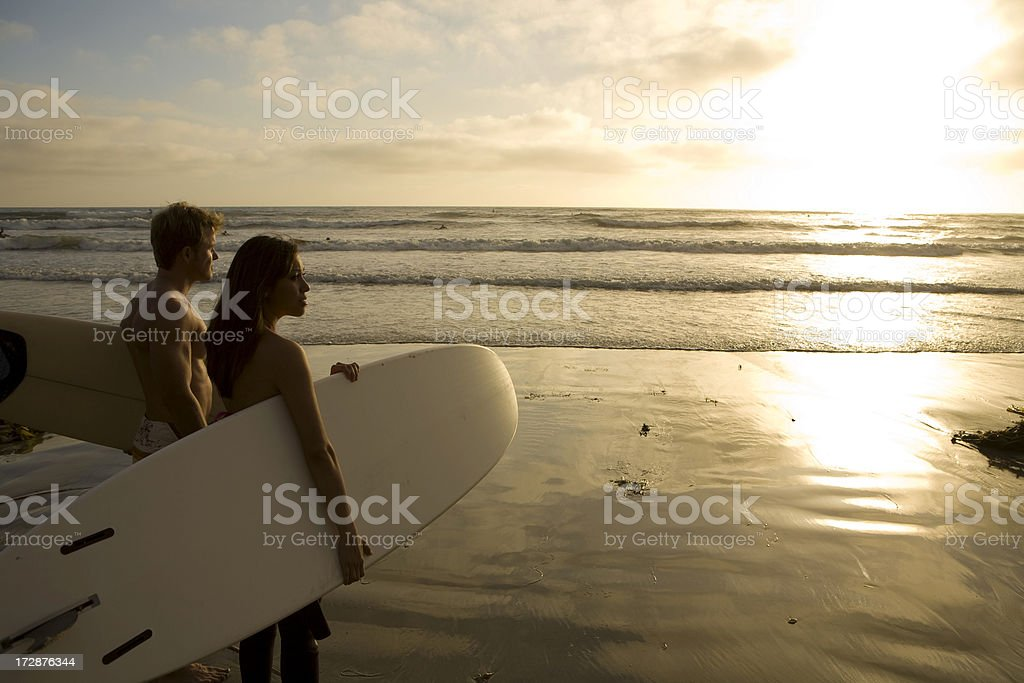 Surfers Watching Sunset 2 royalty-free stock photo