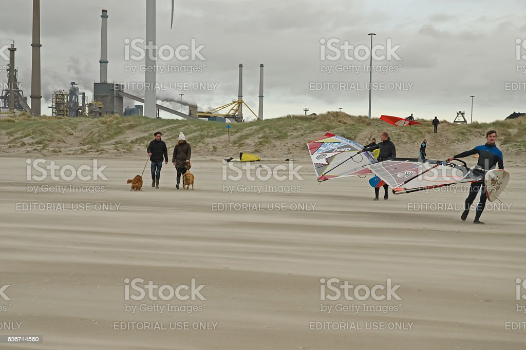 Surfers with Tata steel in the background stock photo
