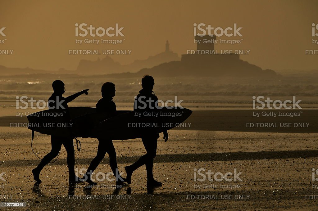 Surfin' St.Ouen, Jersey. stock photo