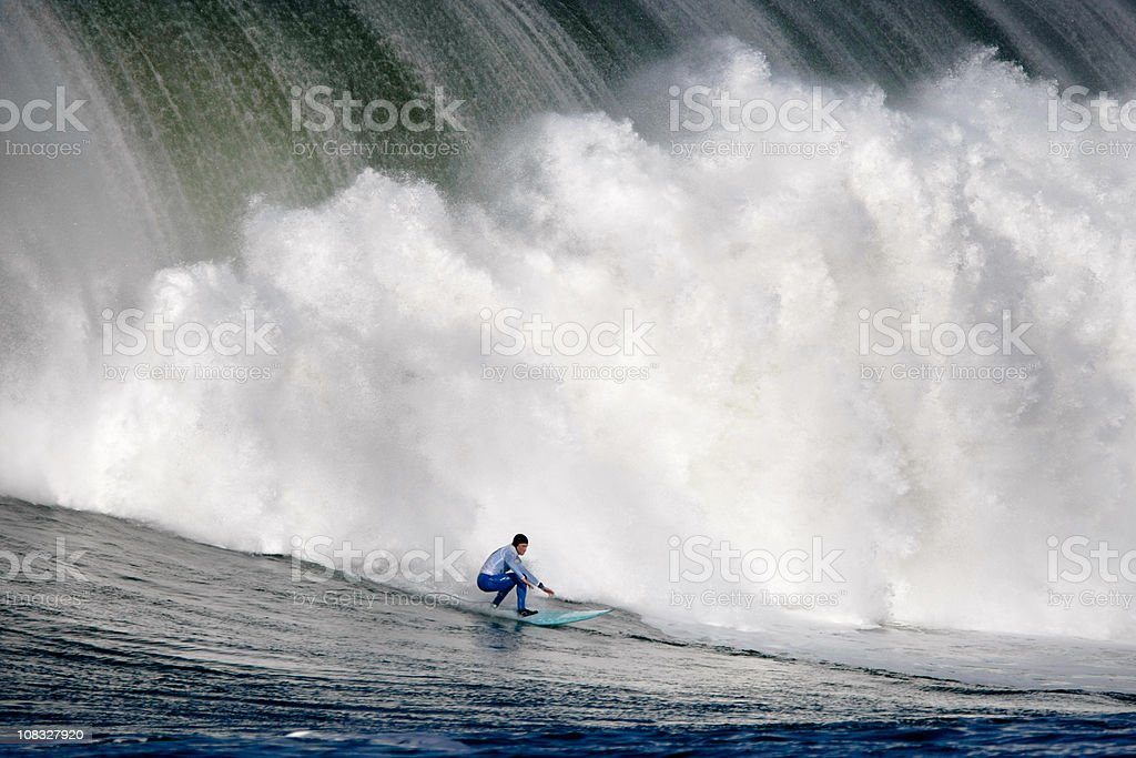 Surfing a Huge Wave royalty-free stock photo