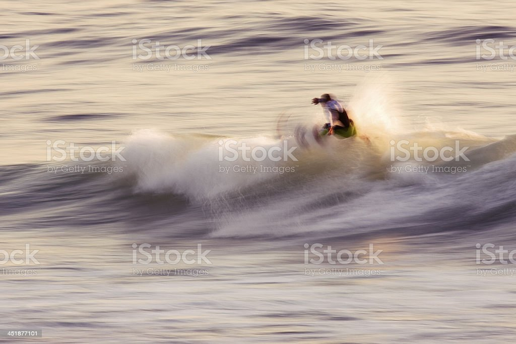 Surfing a wave motion blur stock photo