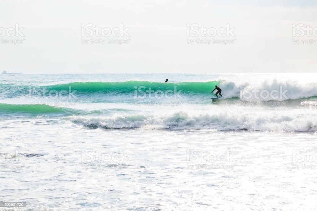 Surfing and beautiful turquoise wave in ocean. stock photo