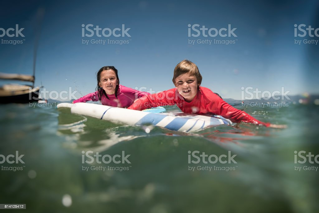 Surfing and racing stock photo