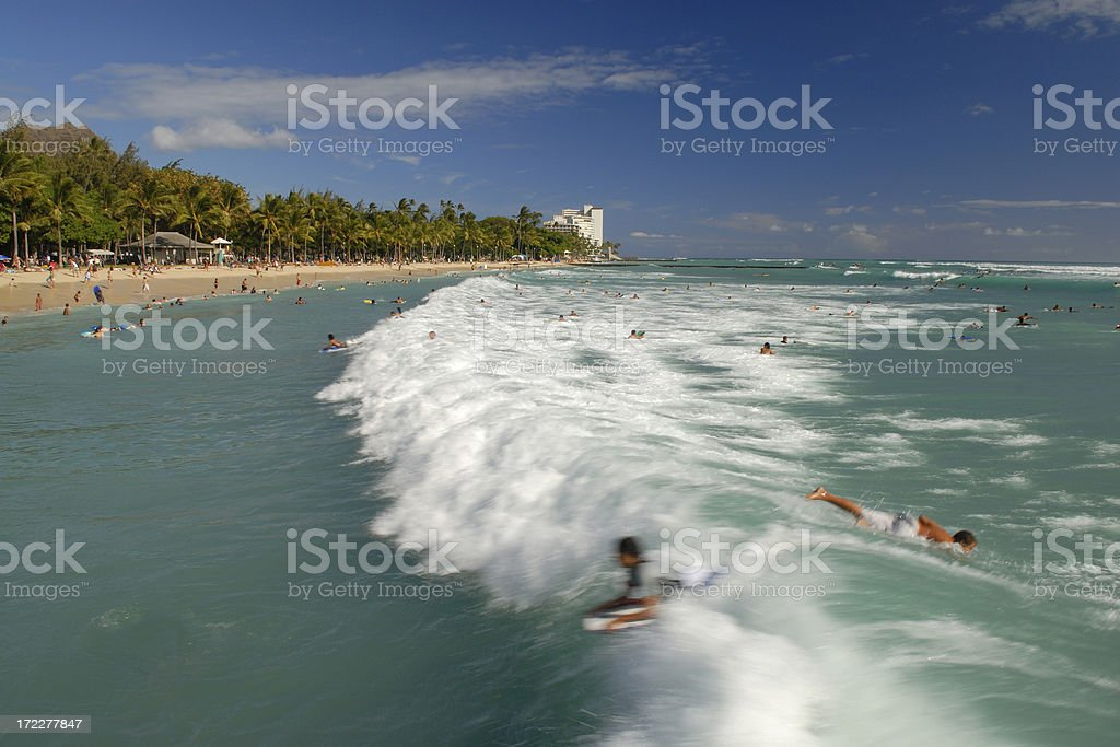 Surfing at Waikiki Beach royalty-free stock photo