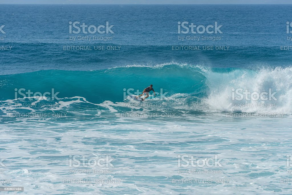 Surfing Blue Waves in Honolua bay stock photo