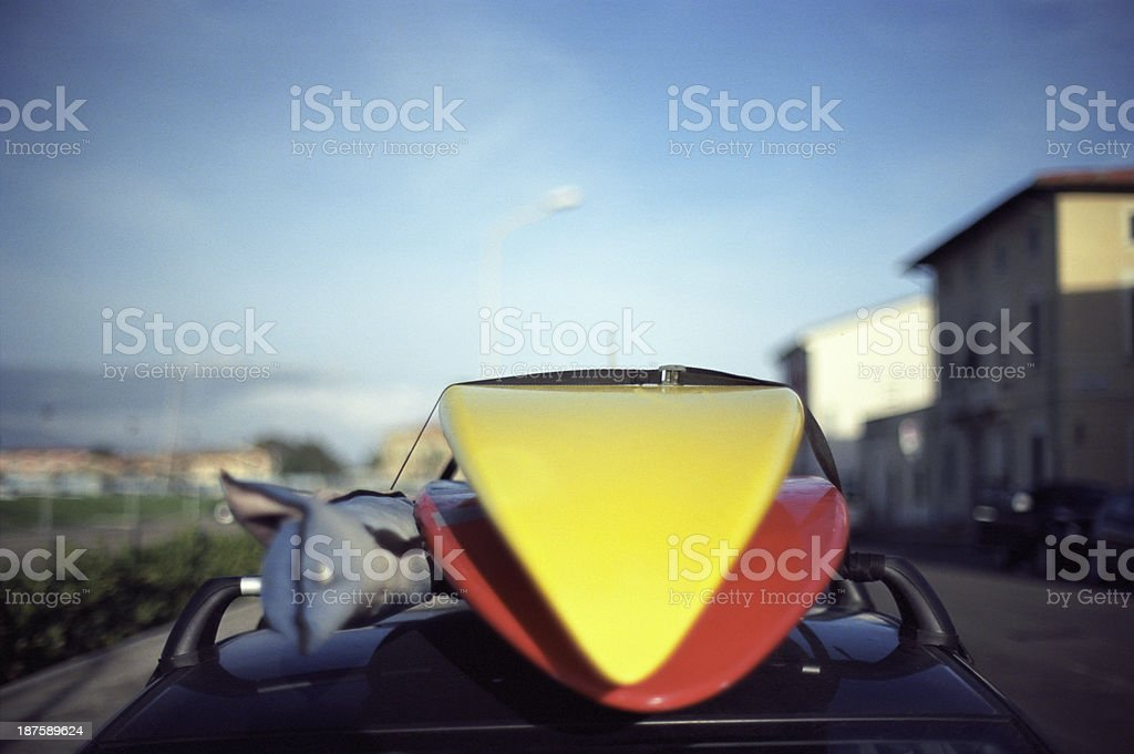 Surfing board on top of a car at the seaside royalty-free stock photo