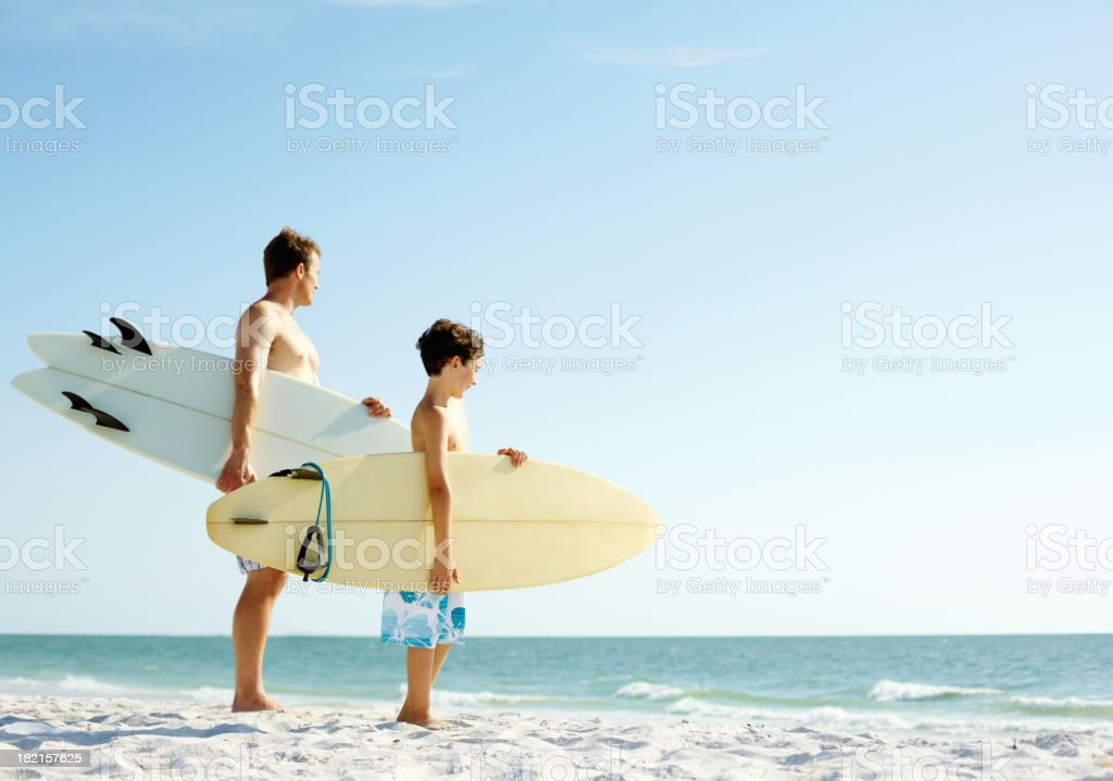Surfing father and son royalty-free stock photo