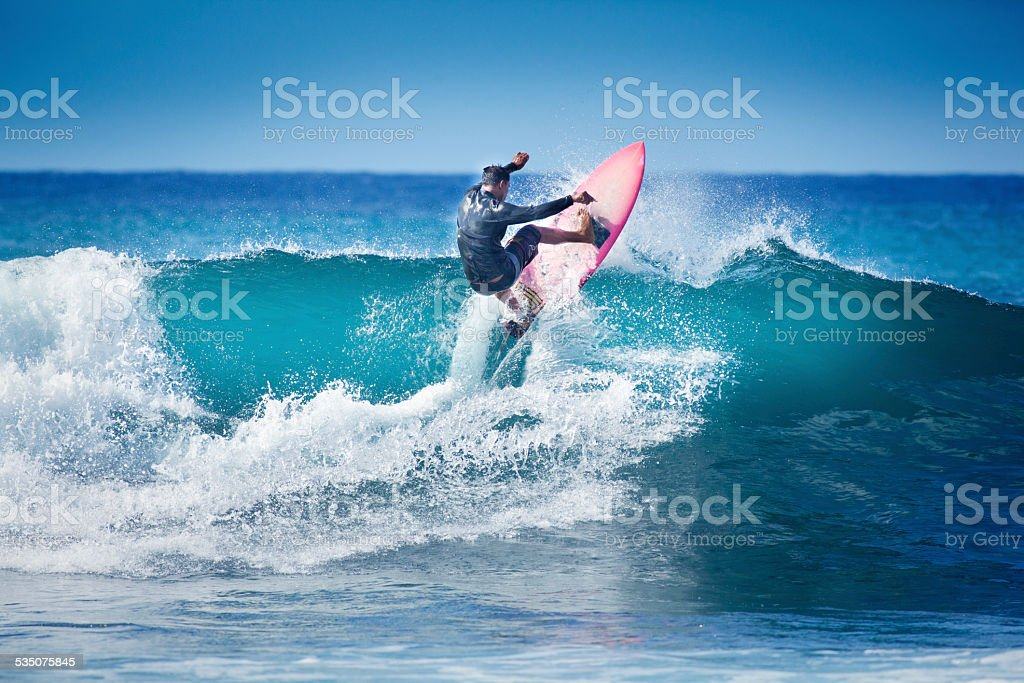 Surfing in Kauai Hawaii stock photo
