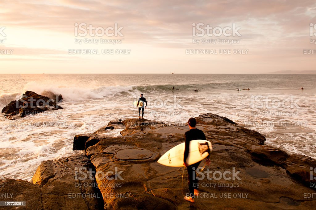 Surfing in Peru at sunset stock photo