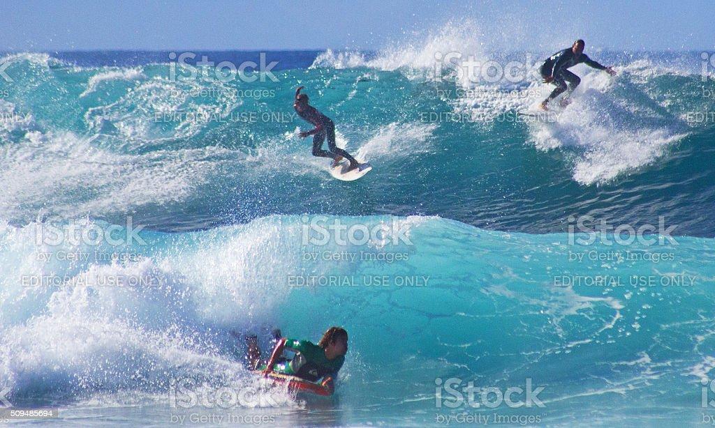 Surfing in Playa De Las Americas. stock photo
