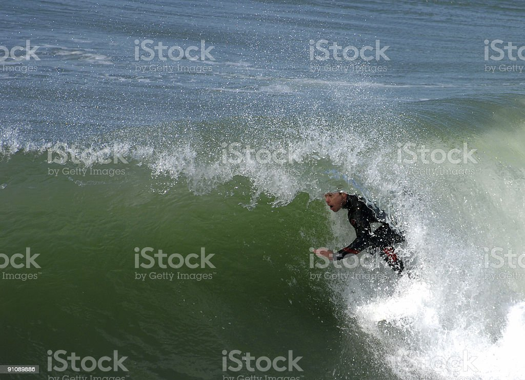 Surfing in the Barrel stock photo