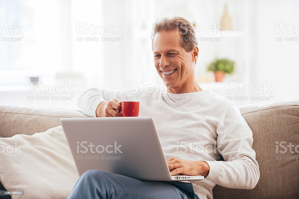 Surfing net at home. stock photo