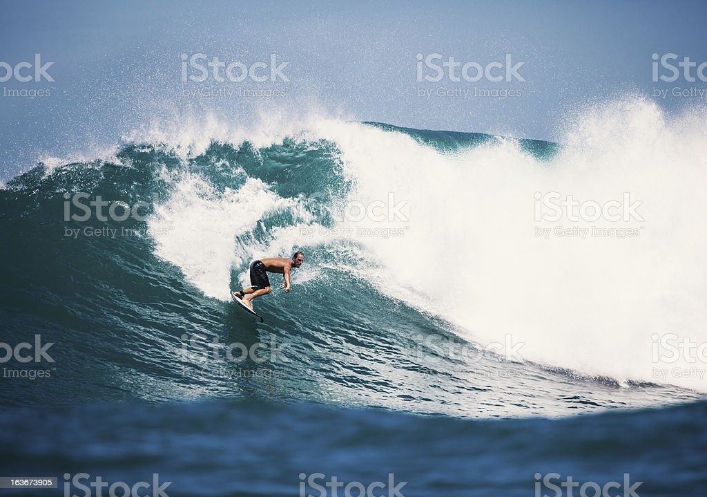 surfing on big wave royalty-free stock photo
