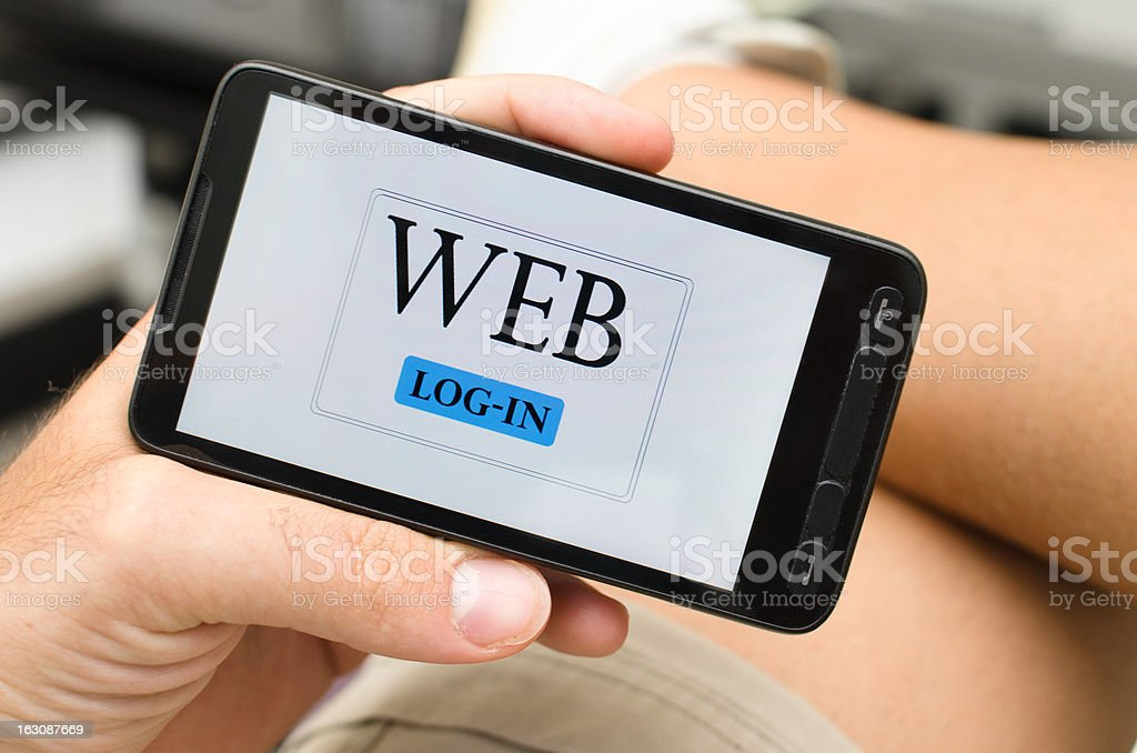Surfing on internet with new Smart phone royalty-free stock photo