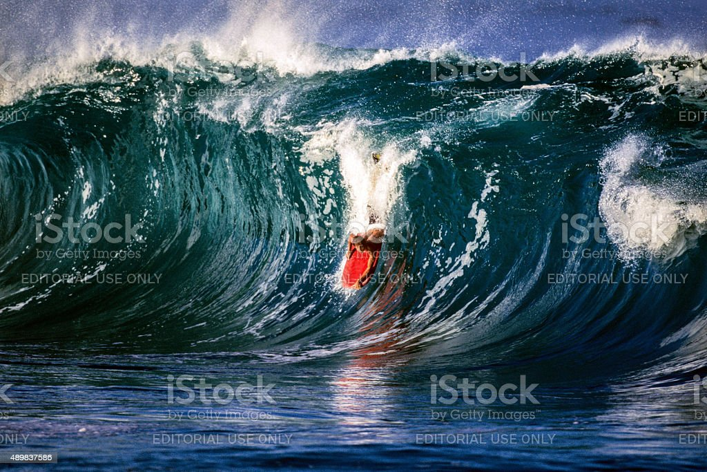 Surfing on the North Shore at Waimea Bay stock photo