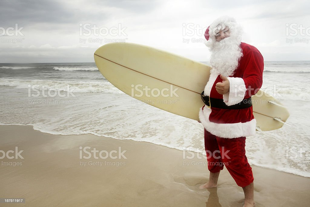 Surfing Santa royalty-free stock photo