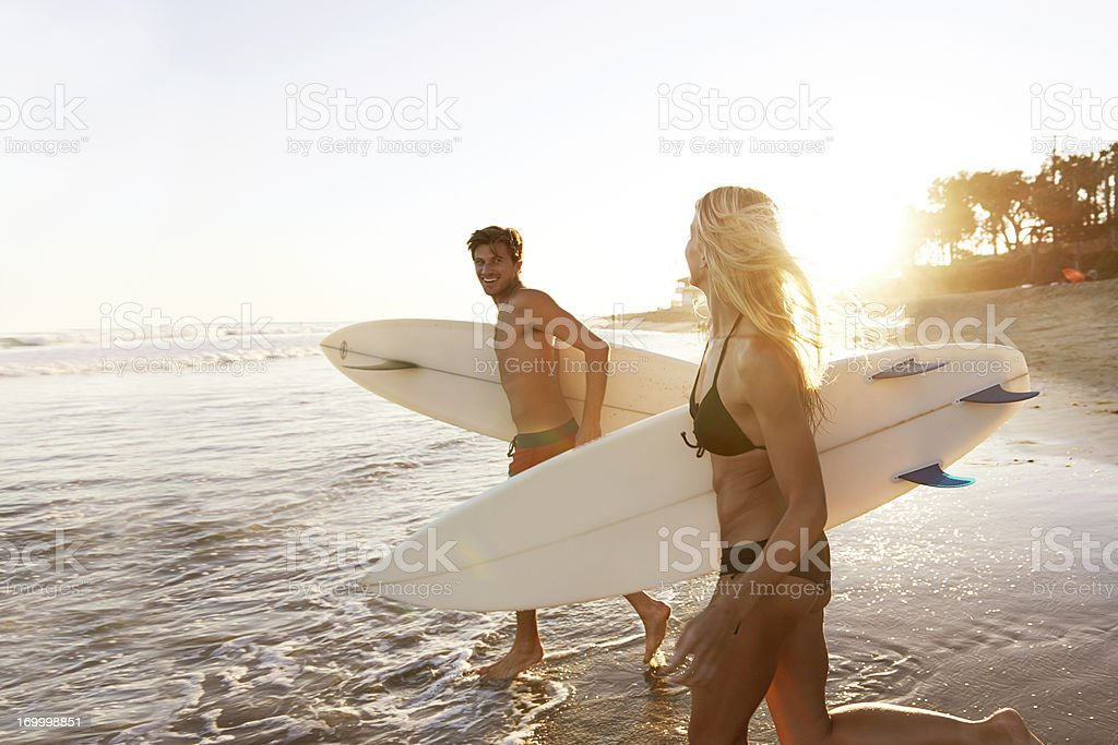 Surfing sweethearts royalty-free stock photo