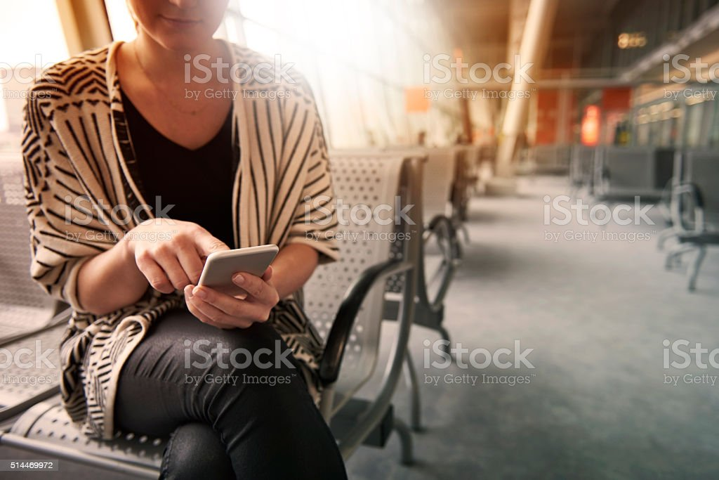 Surfing the net before the flight stock photo