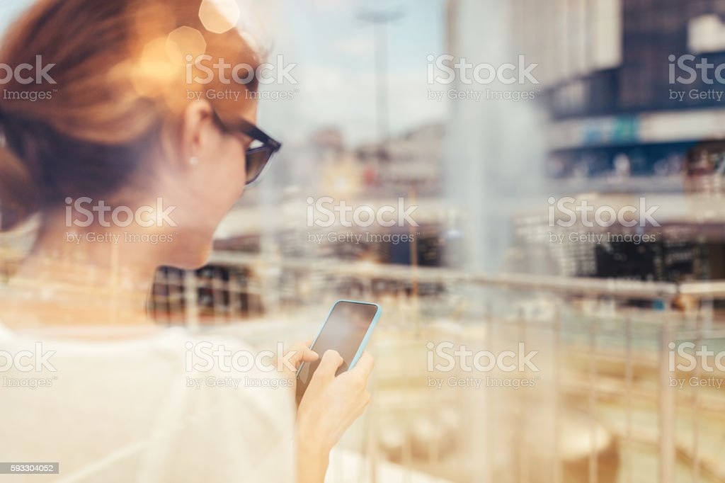 Surfing the net in the city stock photo