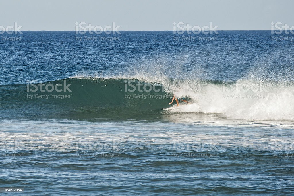 Surfing the Pipe stock photo