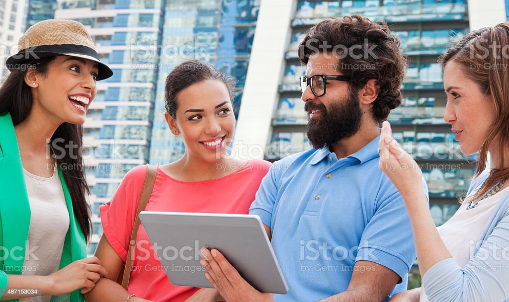 Surfing the web in Dubai Jumeirah Lake Towers. stock photo