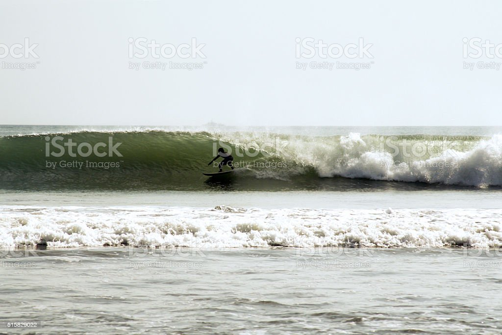 Surfing under the waves in a stormy ocean stock photo