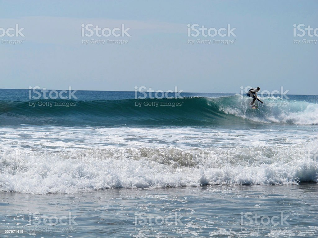 Surfing waves in the ocean. stock photo