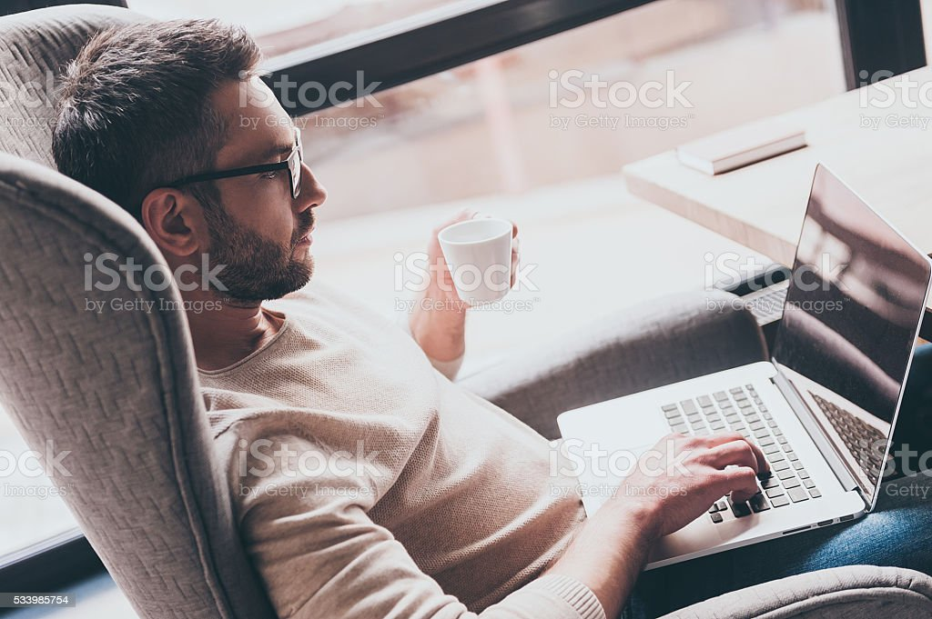 Surfing web from cafe. stock photo