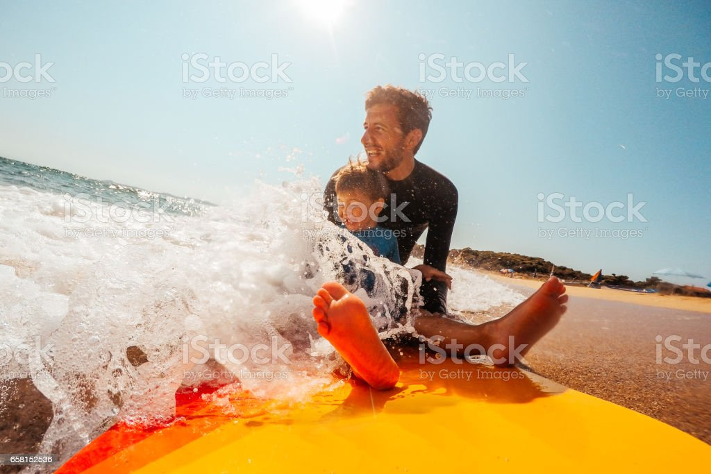 Surfing with my dad stock photo