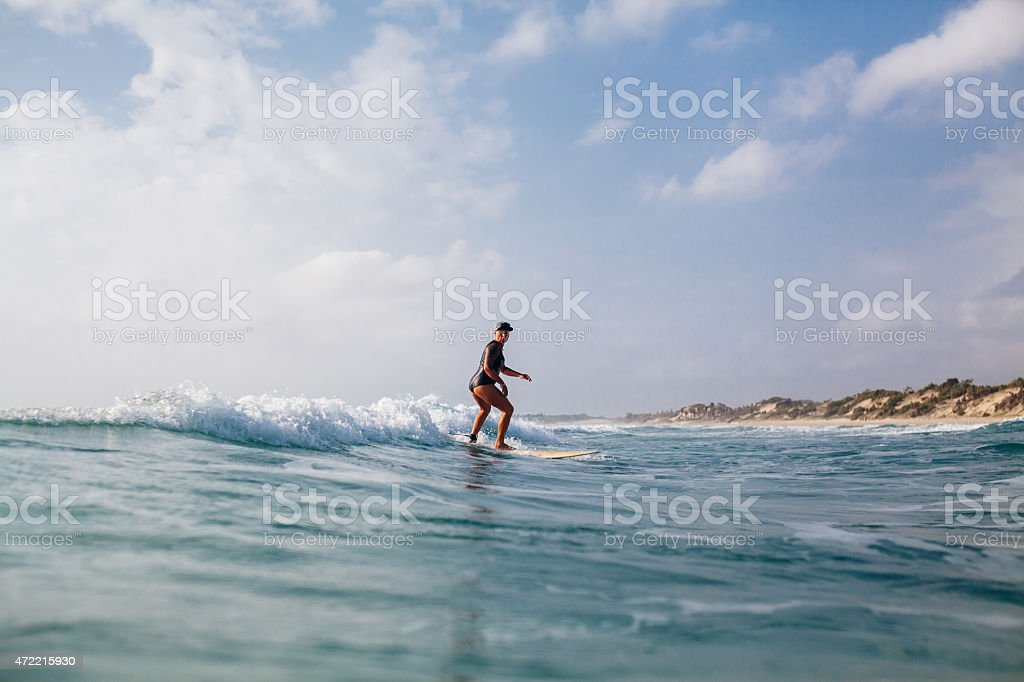 surfing woman with surfing board back view stock photo