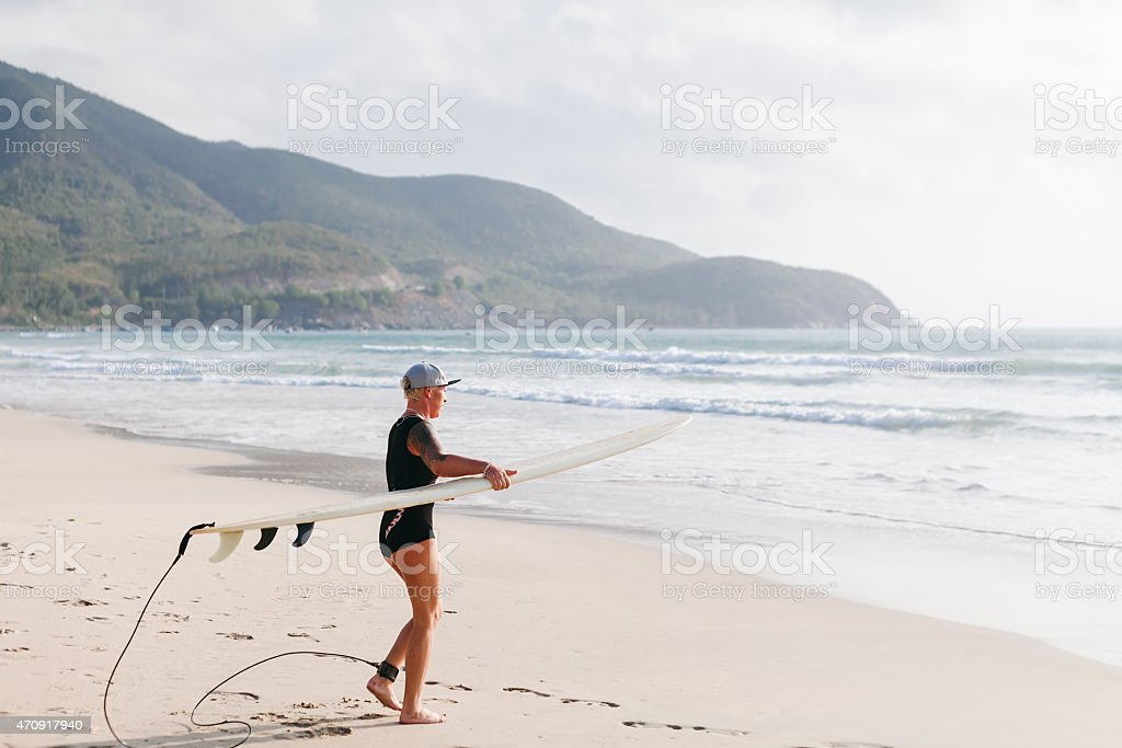 surfing woman with surfing board on the beach stock photo