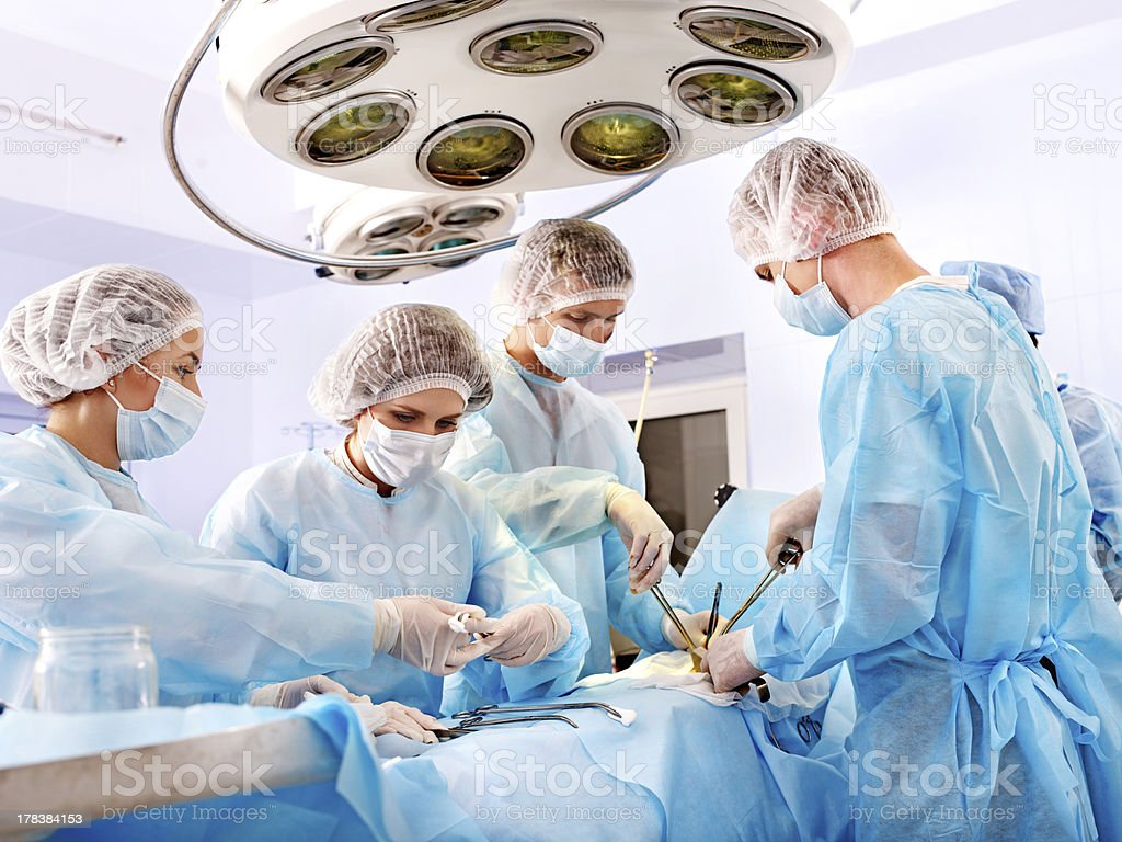 Surgeon at work in operating room. stock photo
