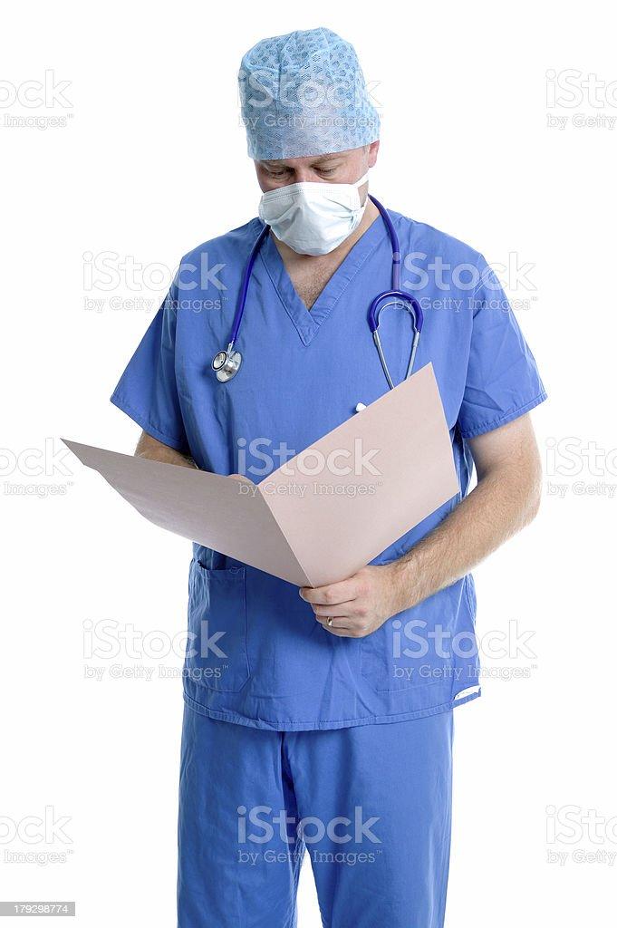 Surgeon examining notes. stock photo
