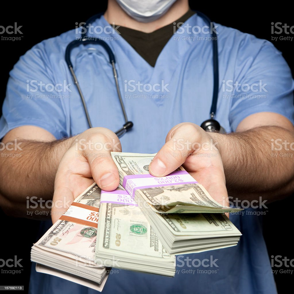 Surgeon in blue giving out cash. royalty-free stock photo