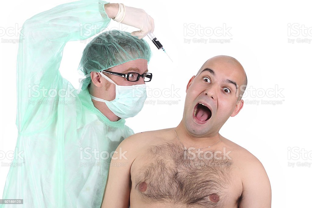 surgeon injecting a scare patient royalty-free stock photo