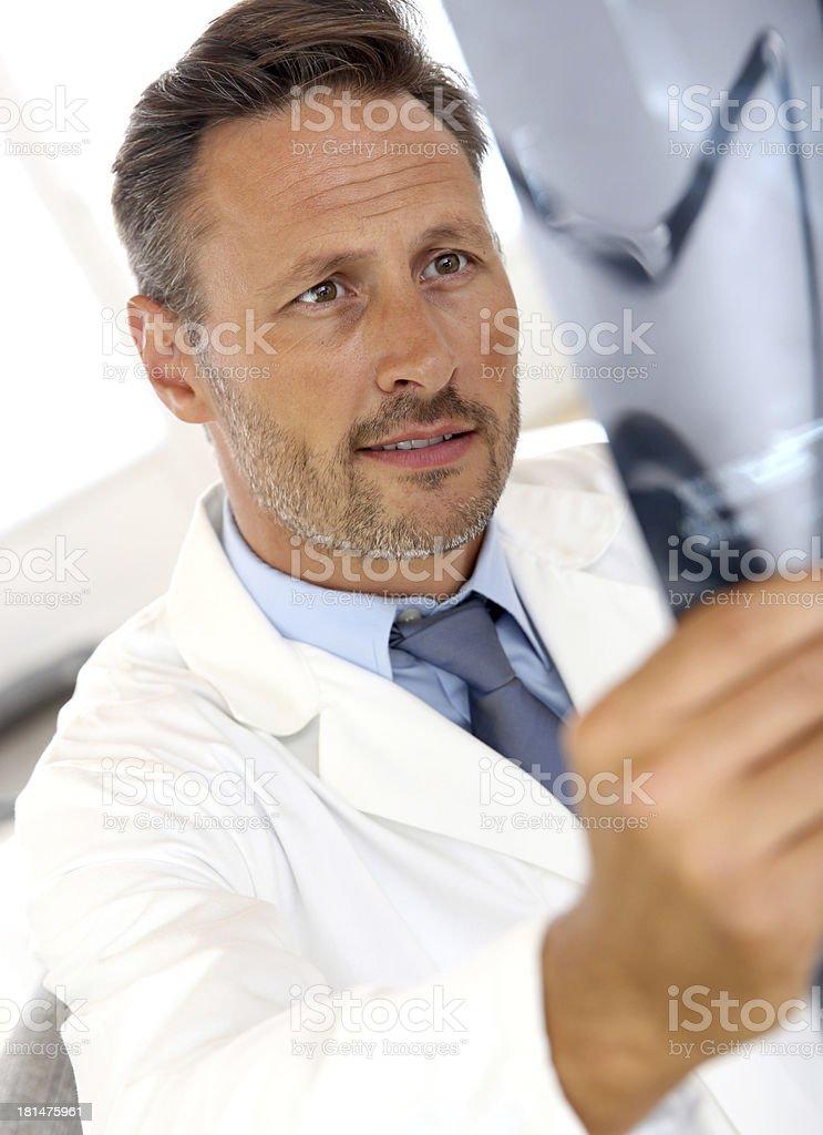 Surgeon looking at radiography stock photo