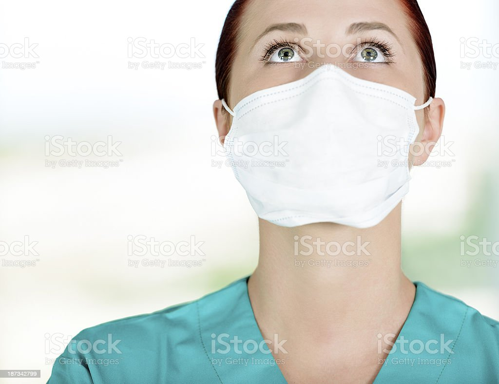 surgeon looking up royalty-free stock photo